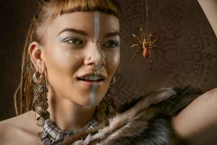 woman looking on spider