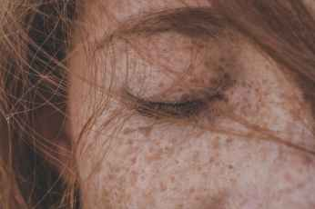 close up photo of woman s face