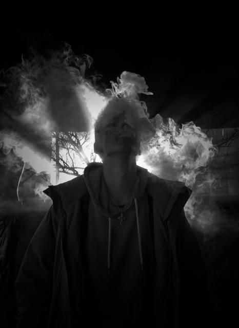 man in jacket smoking a cigarette